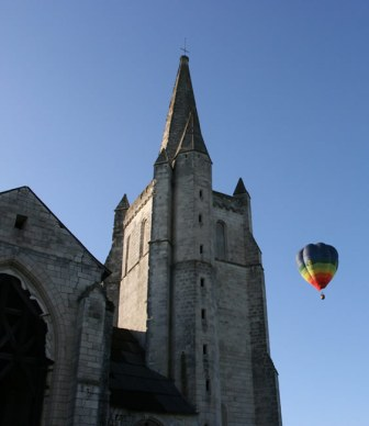 Hot air balloon passing the Abbay de Bois Aubrey Gites.